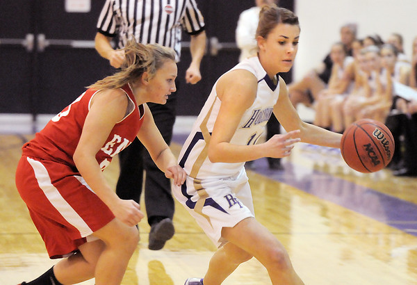 Taylor Helbig, Holy Family, drives the ball around Kayla Cheney, Eaton during Tuesday's game at Holy Family.<br /> January 4, 2011<br /> staff photo/David R. Jennings