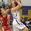 Stephanie Giltner, Holy Family, goes for the basket past Leah Cheney, Eaton during Tuesday's game at Holy Family.<br /> January 4, 2011<br /> staff photo/David R. Jennings