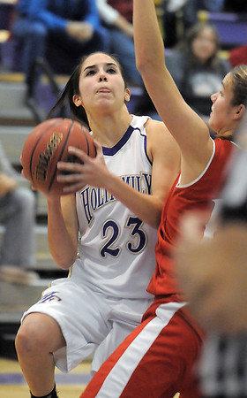 Holy Family's Carolina Gutierrez, goes to the basket against Eaton during Tuesday's game at Holy Family.<br /> January 4, 2011<br /> staff photo/David R. Jennings