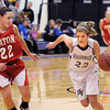 Stephanie Giltner, Holy Family, drives the ball up court past Leah Cheney, Eaton during Tuesday's game at Holy Family.<br /> January 4, 2011<br /> staff photo/David R. Jennings