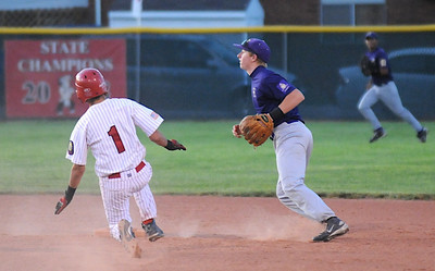 Short stop Connor Meining, right, Holy Family,  waits for the ball while Gus Jones, Eaton, slides to second base during the state Legion B baseball playoffs Thursday at Eaton High School.  July 23, 2009 staff photo/David Jennings