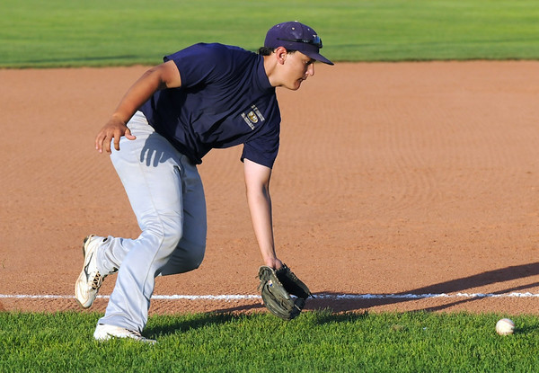Holy Family baseball third baseman Joe Walls scoops up the ball during the state Legion B baseball playoffs against Eaton Thursday at Eaton High School.<br /> <br /> July 23, 2009<br /> staff photo/David Jennings