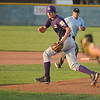 Pticher Josh Tinnon, Holy Family runs to the ball for a throw to first base during play against Eaton in the state Legion B baseball playoffs Thursday at Eaton High School.<br /> <br /> July 23, 2009<br /> staff photo/David Jennings