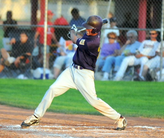 Holy Family's Sean Urban swings against Eaton during the state Legion B baseball playoffs Thursday at Eaton High School.<br /> <br /> July 23, 2009<br /> staff photo/David Jennings