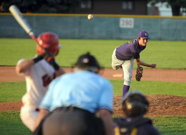 Pitcher  Josh Tinnon, Holy Family baseball, throws against Eaton baseball during the state Legion B baseball playoffs Thursday at Eaton High School.<br /> <br /> July 23, 2009<br /> staff photo/David Jennings