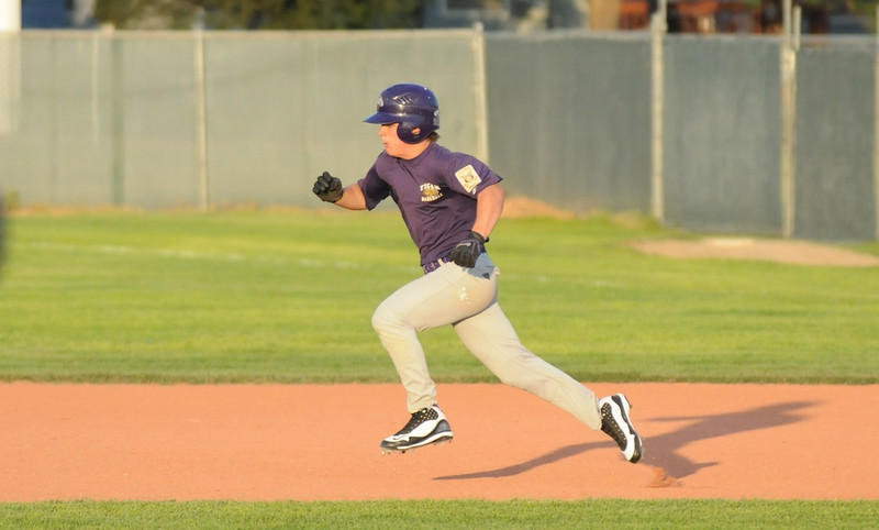 Ryan Silva, Holy Family, makes a dash to second base during play against Eaton in the state Legion B baseball playoffs Thursday at Eaton High School.<br /> <br /> July 23, 2009<br /> staff photo/David Jennings