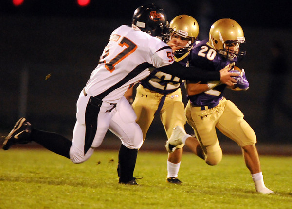 Nick Welder, right, Holy Family, tries to break the tackle by Tyler Alore, Erie, during play at Mike G. Gabriel Stadium on Friday.<br /> <br /> Sept. 25, 2009<br /> Staff photo/David R. Jennings