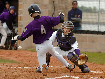Holy Family's catcher Rob McCandlish eyes the ball while Estes Park's Gage Smith slides to home plate during Saturday's district game at Holy Family. May 14, 2011 staff photo/David R. Jennings