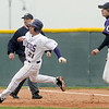Holy Family's Rob McCandlish runs to second base past Conner Bryant, Estes Park during Saturday's district game at Holy Family.<br /> May 14, 2011<br /> staff photo/David R. Jennings