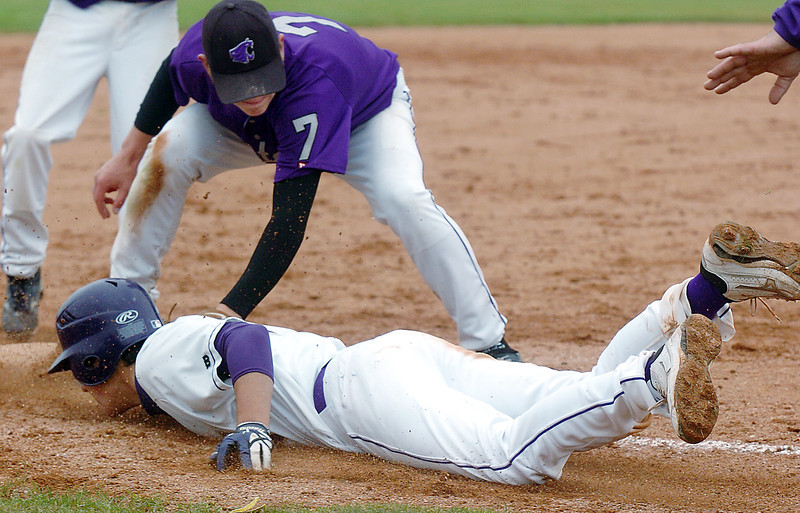 Holy Family's Garrett West dives back to third base past Estes Park's Cam Bogener during Saturday's district game at Holy Family.<br /> May 14, 2011<br /> staff photo/David R. Jennings