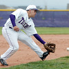 Holy Family's Rob McCandlish scoops up an infield hit by Estes Park during Saturday's district game at Holy Family.<br /> May 14, 2011<br /> staff photo/David R. Jennings