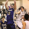 Josh Tinnon, Holy Family, goes up for two against Faith Christian during the game on Thursday at Faith Christian.<br /> <br /> January 7, 2010<br /> Staff photo/David R. Jennings