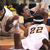 Josh Tinnon, Holy Family, fights for possession of a loose ball with Chris Brekke, Faith Christian during the game on Thursday at Faith Christian.<br /> <br /> January 7, 2010<br /> Staff photo/David R. Jennings
