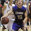 Joe Sommers, Holy Family, dribbles to the basket  past Faith Christian during the game on Thursday at Faith Christian.<br /> <br /> January 7, 2010<br /> Staff photo/David R. Jennings