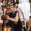 Joe Sommers, Holy Family, waits to go to the basket past Torrey Smith, Faith Christian during the game on Thursday at Faith Christian.<br /> <br /> January 7, 2010<br /> Staff photo/David R. Jennings