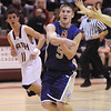 Holy Family's Bryan Murphy passes the ball past Faith Christian during the game on Thursday at Faith Christian.<br /> <br /> January 7, 2010<br /> Staff photo/David R. Jennings