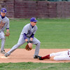 Holy Family's Connor Meining and Sean Urban try to tag out Dylan Tucker, Faith Christian during Saturday's game at Faith Christian.<br /> <br /> April 17, 2010<br /> Staff photo/David R. Jennings