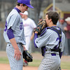 Holy Family's Josh Tinnon talks with cathcer Rob McCandlish during Saturday's game at Faith Christian.<br /> <br /> April 17, 2010<br /> Staff photo/David R. Jennings
