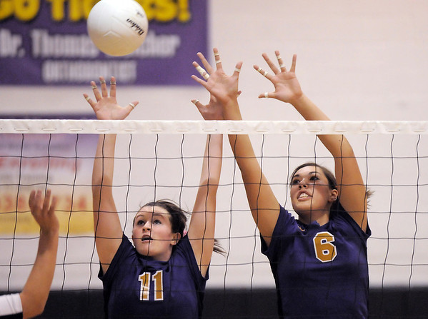 Holy Family's Blaire Mikesell, left, and Mary Franz block the ball during Tuesday's match against Jefferson Academy at Holy Family.<br /> September 27, 2011<br /> staff photo/ David R. Jennings
