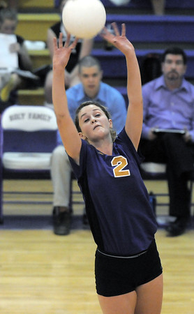 Kelsey Cribari, Holy Family, sets the ball during Tuesday's match against Jefferson Academy at Holy Family.<br /> September 27, 2011<br /> staff photo/ David R. Jennings