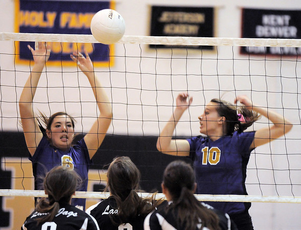 Holy Family's Mary Franz, left, and Claudia Penna block the ball during Tuesday's match against Jefferson Academy at Holy Family.<br /> September 27, 2011<br /> staff photo/ David R. Jennings