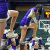 "A Holy Family cheerleader does a ""Tebow"" during a break in the  3A state Final Four game against Kent Denverat CSU on Friday.<br /> <br /> March 8,  2012 <br /> staff photo/ David R. Jennings"