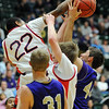Kyle Willis is fouled by Kent Denver's Eduardo White during the 3A state Final Four game at CSU on Friday.<br /> <br /> March 8,  2012 <br /> staff photo/ David R. Jennings