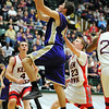 Holy Family's Kyle Willis goes to the basket against Kent Denver's Josh Repine during the 3A state Final Four game at CSU on Friday.<br /> <br /> March 8,  2012 <br /> staff photo/ David R. Jennings
