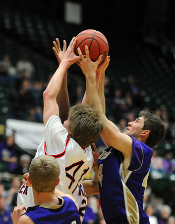 Holy Family's Kyle Willis shoots the ball past Kent Denver's Billy Lane during the 3A state Final Four game at CSU on Friday.<br /> <br /> March 8,  2012 <br /> staff photo/ David R. Jennings