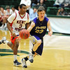Holy Family's Ryan Willis takes the ball downcourt ahead of Kent Denver's Collins Gantz during the 3A state Final Four game at CSU on Friday.<br /> <br /> March 8,  2012 <br /> staff photo/ David R. Jennings