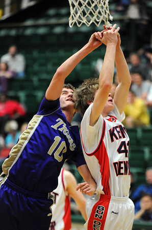 Holy Family's Tanner Stuhr collides with  Kent Denver's Billy Lane under the basket during the 3A state Final Four game at CSU on Friday.<br /> <br /> March 8,  2012 <br /> staff photo/ David R. Jennings