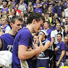Holy Family's Tanner Stuhr, right, is comforted by David Sommers after the Tigers were defeated by Kent Denver 29-26 in the 3A state Final Four game at CSU on Friday.<br /> <br /> March 8,  2012 <br /> staff photo/ David R. Jennings