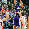 Holy Family's Connor Clay shoots the ball over Kent Denver during the 3A state Final Four game at CSU on Friday.<br /> <br /> March 8,  2012 <br /> staff photo/ David R. Jennings