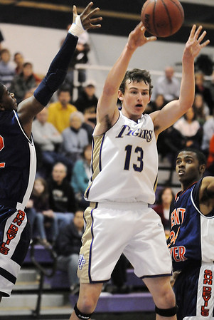 Josh Tinnon, Holy Family, passes the ball around Collins Gantz, Kent Denver, during Friday at Holy Family.<br /> <br /> <br /> February 5, 2010<br /> Staff photo/David R. Jennings