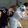 Adam Bakiera, right,  Holy Family, collides with Parker Moss, Kent Denver during play at Mike G. Gabriel Stadium on Tuesday.<br /> <br /> Sept. 29, 2009<br /> Staff photo/David R. Jennings
