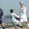 Josh Disberger, right, Holy Family, does a header to teammate Preston Arguello and past Sam Bauer, Kent Denver during play at Mike G. Gabriel Stadium on Tuesday.<br /> <br /> Sept. 29, 2009<br /> Staff photo/David R. Jennings
