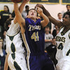Nate Golter, Holy Family, fights for the ball under the basket against Jack Heher and Devon White, Bishop Machebeuf during Thursday's game at Machebeuf.<br /> <br /> <br /> January 21, 2010<br /> Staff photo/David R. Jennings