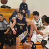 Bryan Murphy, Holy Family, stays ahead of Bishop Machebeuf players while chasing the ball during Thursday's game at Machebeuf.<br /> <br /> <br /> January 21, 2010<br /> Staff photo/David R. Jennings