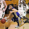 Nick Bovine, Holy Family, drive the ball down court against, Bishop Machebeuf during Thursday's game at Machebeuf.<br /> <br /> <br /> January 21, 2010<br /> Staff photo/David R. Jennings