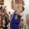 Holy Family's Bryan Murphy goes up for two against Bishop Machebeuf during Thursday's game at Machebeuf.<br /> <br /> <br /> January 21, 2010<br /> Staff photo/David R. Jennings