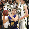 Bryan Murphy, Holy Family, pauses before going to the basket past Fitsum Melles and Casey Kipp, Bishop Machebeuf, during Thursday's game at Machebeuf.<br /> <br /> <br /> January 21, 2010<br /> Staff photo/David R. Jennings