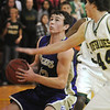 Josh Tinnon, Holy Family, sets under the basket against Casey Kipp,  Bishop Machebeuf during Thursday's game at Machebeuf.<br /> <br /> <br /> January 21, 2010<br /> Staff photo/David R. Jennings