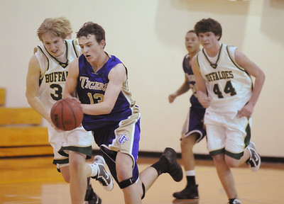 Josh Tinnon, Holy Family, drives the ball down court against, Bishop Machebeuf during Thursday's game at Machebeuf.   January 21, 2010 Staff photo/David R. Jennings