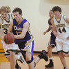 Josh Tinnon, Holy Family, drives the ball down court against, Bishop Machebeuf during Thursday's game at Machebeuf.<br /> <br /> <br /> January 21, 2010<br /> Staff photo/David R. Jennings