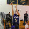 Bryan Murphy, Holy Family, shoots long against Bishop Machebeuf during Thursday's game at Machebeuf.<br /> <br /> <br /> January 21, 2010<br /> Staff photo/David R. Jennings