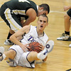 BE1212HBASK09<br /> Tanner Stuhr,  Holy Family recovers a loose ball from Manitou Springs during Wednesday's game at Holy Family.<br /> December  8, 2010<br /> staff photo/David R. Jennings