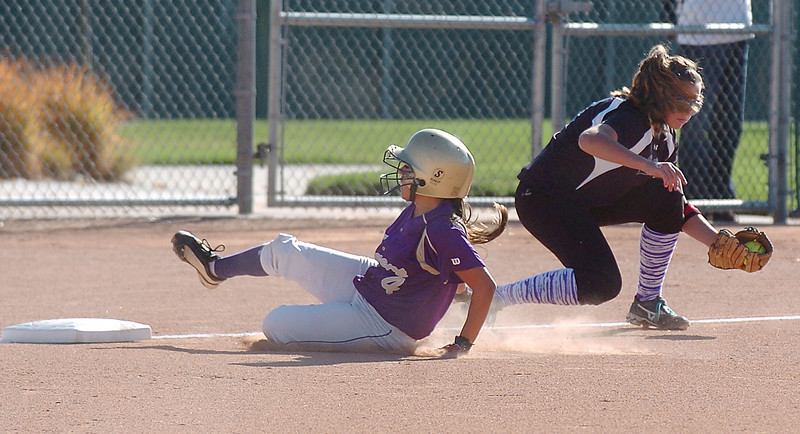 Holy Family's Moriah Turney slides to third past  Middle Park's Mikey Cross during state regional play at the Broomfield Industrial Park on Saturday.<br /> <br /> October 16, 2010<br /> staff photo/David R. Jennings