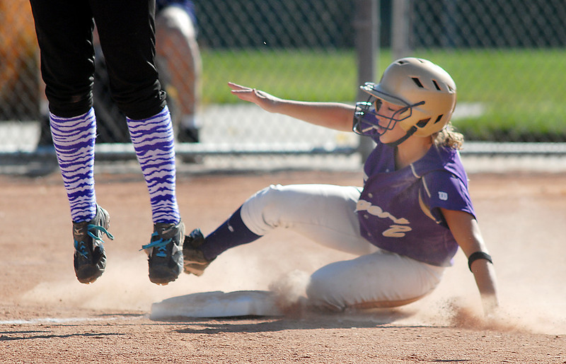 Holy Family's Beth Peterson slides to third past Mikey Cross, Middle Park, during state regional play at the Broomfield Industrial Park on Saturday.<br /> <br /> October 16, 2010<br /> staff photo/David R. Jennings