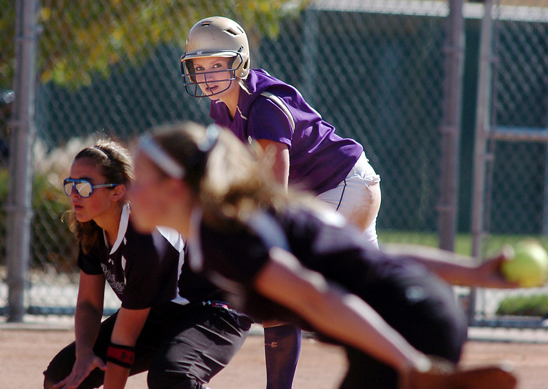 Holy Family's Amy Baumberger keeps an eye on the Middle Park  infield from third base during state regional play at the Broomfield Industrial Park on Saturday.<br /> <br /> October 16, 2010<br /> staff photo/David R. Jennings