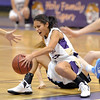 Lindsey Chavez, Holy Family fights for control of the ball against Bre Fiske, Mountain Range during Thursday's game at Holy Family.<br /> <br /> <br /> November 29, 2012<br /> staff photo/ David R. Jennings